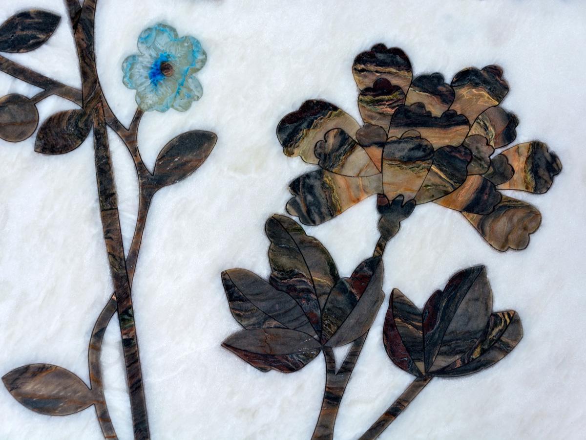 inlegwerk natuursteen met bloemen